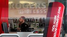 An employee works inside a Rogers Wireless retail store in Vancouver, B.C (DARRYL DYCK/DARRYL DYCK/THE CANADIAN PRESS)