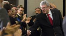 Canada Prime minister Stephen Harper shaking hands with the public as he arrives to announce Energy innovation project,Friday, May 2, 2013 in Quebec City. (Clement Allard/THE CANADIAN PRESS)