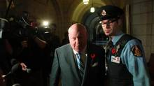 Senator Mike Duffy arrives to the Senate on Parliament Hill in Ottawa on Oct. 28, 2013. (DAVE CHAN FOR THE GLOBE AND MAIL)