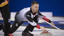 Canada skip Brad Gushue makes a shot during the 10th draw against China at the Men's World Curling Championships in Edmonton, on April 4, 2017. (JONATHAN HAYWARD/THE CANADIAN PRESS)