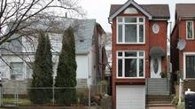 What you get for $679,000 in Toronto. 186 Gamble Ave., in East York. Asking Price: $679,000. This is a 23-year-old detached house with three bedrooms and four bathrooms. The living room has nine-and-a-half-foot high ceilings, a wood-burning fireplace and a walk-out to the patio. (Photo by D'Arcy McGovern)