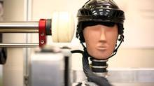A test dummy performs an impact test at the Neurotrauma Impact Science Laboratory at the University of Ottawa. Advocates say research on head injuries must continue. (Dave Chan For The Globe and Mail)