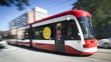 The Toronto Transit Commision (TTC) shows off the brand new state-of-the-art street cars in Toronto, Ontario, Monday, August 25, 2014. The new fleet of streetcars will begin rolling out August 31 and will feature wheelchair ramps, air conditioning, and bike racks. (Photo by Kevin Van Paassen for The Globe and Mail ) (Kevin Van Paassen for The Globe and Mail)