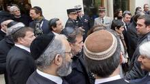 Jewish authorities wear their traditional skullcap during a visit of the Interior Minister Bernard Cazeneuve at the synagogue in Marseilles, southern France, on Thursday, Jan. 14, 2016. A leading Jewish authority in Marseilles asked fellow Jews on Tuesday to refrain wearing the skullcap in order to stay safe after a machete-wielding teen attacked a Jewish teacher. (Claude Paris/AP)