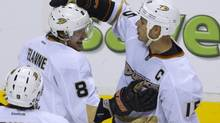 Anaheim Ducks Teemu Selanne (8) is congratulated by teammate Ryan Getzlaf (15) after scoring against the Vancouver Canucks during the second period of their NHL hockey game in Vancouver, British Columbia January 19, 2013. (ANDY CLARK/REUTERS)