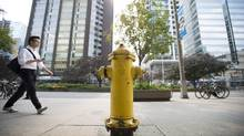 The fire hydrant located at 393 University Avenue in Toronto is pictured on Thursday, August 7, 2014. The hydrant, located approximately 20 feet from the street, is the cause of more parking infractions than any other hydrant in the city. (Darren Calabrese/THE CANADIAN PRESS)