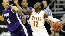 Texas Longhorns guard Myck Kabongo (12) pushes away TCU Horned Frogs guard Kyan Anderson (5) during the Longhorn's win in the first round of the NCAA men's Big 12 basketball tournament at the Sprint Center in Kansas City, Missouri, March 13, 2013. (DAVE KAUP/REUTERS)