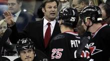 Carolina Hurricanes new head coach Kirk Muller, center left, directs the Hurricanes against the Florida Panthers during the first period of an NHL hockey game, Tuesday, Nov. 29, 2011, in Raleigh, N.C. The Panthers won 3-1. (AP Photo/Gerry Broome) (Gerry Broome/AP)
