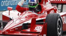 Driver Dario Franchitti of Scotland celebrates winning on his victory lap at the IRL IndyCar Series Honda Indy Toronto race, July 12, 2009. REUTERS/Mark Blinch (CANADA SPORT MOTOR RACING)