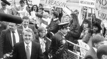 Protesters greet prime minister Brian Mulroney at a Toronto television station on Oct. 27, 1988. (John McNeill/The Globe and Mail)
