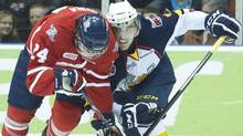 Barrie Colts defenceman Aaron Ekblad, right, battles for the puck against Oshawa Generals forward Sebastian Uvira, left, during first period OHL hockey action in Oshawa, Ont., on .Feb. 20, 2012. (NATHAN DENETTE/THE CANADIAN PRESS)
