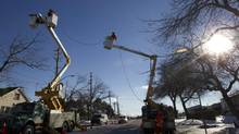 Toronto Hydro crews continue to repair lines to homes and offices in Scarborough on December 30, 2013. (Peter Power/The Globe and Mail)