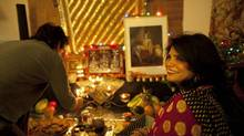 Alka Pandit and her son Mohan celebrate Diwali by lighting candles at their Richmond Hill home Nov 13, 2012 to begin the five day 'festival of lights.' (Moe Doiron/The Globe and Mail)
