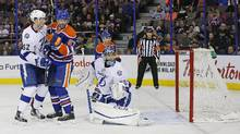 Edmonton Oilers forward Ryan Nugent-Hopkins (93) (not in photo) scores while forward Benoit Pouliot (67) screens Tampa Bay Lightning goaltender Ben Bishop (30) during the second period at Rexall Place in Edmonton on Friday, Jan. 8, 2016. (Perry Nelson/USA Today Sports)