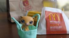 Photographs of a MacDonalds Happy Meal and the toy that comes with it. (Fred Lum/Fred Lum/The Globe and Mail)