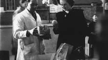 Conservative candidate Margaret Roberts (later Thatcher) buys a pint of peanuts and studies the quality of a lemon while shopping in Dartford, Kent, England in 1950, where she was standing as Tory MP. (AP)