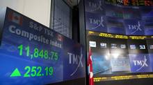 The screens at the TMX Broadcast Centre in Toronto show the closing numbers of the TSX at + 252.19 on Tuesday, July 3, 2012. (Matthew Sherwood)
