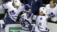 Toronto Maple Leafs center Mikhail Grabovski (84) celebrates his winning goal with teammates Tomas Kaberle (15), defenseman Mike Komisarek, far left, and goalie Jean-Sebastien Giguere, far right, near the end of the third period of a NHL hockey game in Boston, Tuesday, Feb. 15, 2011. Toronto won 4-3. (Elise Amendola/Elise Amendola/AP)