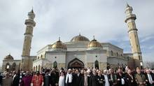 A group of interdenominational religious leaders and their supporters gather outside the Islamic Center of America mosque to rally for peace in Dearborn, Michigan on April 21, 2011. (Rebecca Cook / Reuters)
