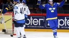 Sweden's Loui Eriksson (right) celebrates a goal against Finland during their 2013 IIHF Ice Hockey World Championship semi-final match at the Globe Arena in Stockholm May 18, 2013. (ARND WIEGMANN/REUTERS)