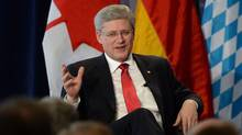 Prime Minister Stephen Harper takes part in a question and answer session with the Bavarian Business Association in Munich, Germany on Wednesday, March 26, 2014. (Sean Kilpatrick/THE CANADIAN PRESS)