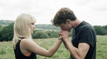 Saoirse Ronan, left, and George MacKay in a scene from How I Live Now. (AP)