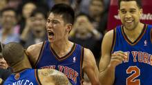 New York Knicks guard Jeremy Lin celebrates with teammates Tyson Chandler and Landry Fields after his game winning three-pointer in the final second of NBA action against the Toronto Raptors in Toronto on Tues., Feb. 14, 2012. (Frank Gunn/FRANK GUNN/THE CANADIAN PRESS)