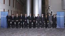 """Trade ministers from a dozen Pacific nations in Trans-Pacific Partnership Ministers meeting post in TPP Ministers """"Family Photo"""" in Atlanta, Georgia. (HANDOUT/Reuters)"""