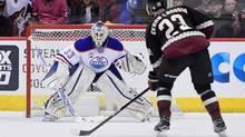 Arizona Coyotes defenseman Oliver Ekman-Larsson (23) scores on Edmonton Oilers goalie Cam Talbot (33) during a shootout at Gila River Arena. (Matt Kartozian/USA Today Sports)