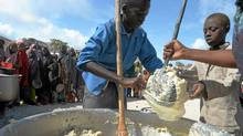 A Somali boy receives a ration of cornmeal in Mogadishu on August 15, 2011, in the courtyard of a Somali Non-governmental Organization who is partnered with the World Food Program. (ROBERTO SCHMIDT/AFP/Getty Images/ROBERTO SCHMIDT/AFP/Getty Images)