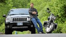 Dave Salmoni, adventurer, zoologist, animal trainer and a television host with his Jeep Grand Cherokee and his Harley Fat Bob. (Fred Lum/Fred Lum/The Globe and Mail)