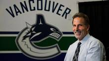 Vancouver Canucks' coach John Tortorella laughs during an interview following a news conference after he was hired by the NHL hockey team in Vancouver, B.C., on Tuesday June 25, 2013. (DARRYL DYCK/THE CANADIAN PRESS)