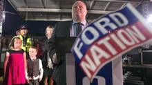 Rob Ford addresses the crowd at Ford Fest, as his wife, Renata, and children, Stephanie and Doug, look on on Saturday. (Chris Young/THE CANADIAN PRESS)