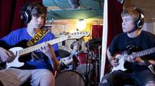 From left, Louis Thomas, 14, Maxim Lukasik, 13, and Colin Gerhart, 15, of W.D.H.A.N. (We Don't Have A Name) rehearse and record a few songs at Don Kerr's house in Toronto. (Matthew Sherwood for The Globe and Mail)