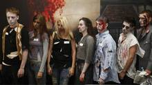 "Candidates queue to audition for the job of ""Zombie"" outside the London Bridge Experience visitor attraction in London July 28, 2009. The successful candidate will have the role of scarring visitors in the tombs underneath the bridge. (STEPHEN HIRD)"