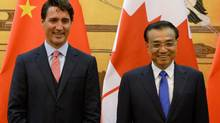 Canadian Prime Minister Justin Trudeau stands with the Premier of the People's Republic of China, Li Keqiang, during a signing ceremony for several tentative agreements in Beijing, China, on Wednesday, August 31, 2016. THE CANADIAN PRESS/Adrian Wyld (Adrian Wyld/THE CANADIAN PRESS)