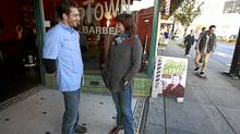 Independent Vancouver city council candidate Sandy Garossino chats with Jordi Sanch, left, a barber with Uptown Barbers, as she main-streets on Main Street Nov. 6, 2011 (Jeff Vinnick/The Globe and Mail/Jeff Vinnick/The Globe and Mail)