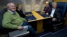 Canadian Prime Minister Stephen Harper speaks with former prime ministers Brian Mulroney(left), Kim Campbell and Jean Chretien on board a government plane travelling to South Africa Sunday December 8, 2013. (Adrian Wyld/THE CANADIAN PRESS)