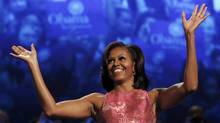 U.S. first lady Michelle Obama waves before addressing the first session of the Democratic National Convention in Charlotte, N.C. on Sept. 4, 2012. (Eric Thayer/REUTERS)
