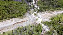 A section of The Alaska Highway is shown washed away near Rancheria, Yukon, about 320 km south of Whitehorse on Friday, June 8, 2012. (Emily Younker/THE CANADIAN PRESS/WHITEHORSE STAR)