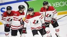 From left: Canada's Mitchell Stephens, Travis Dermott, Travis Konecny and Roland McKeown celebrate the 4-1 goal during the 2016 IIHF World Junior Ice Hockey Championship match. (Roni Rekomaa/AP)