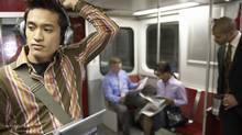 Group of people in subway train (Darrin Klimek/Getty Images)