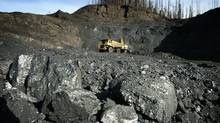 """""""Blueberry's ancestors would not recognize our territory today,"""" says Chief Marvin Yahey of the Blueberry First Nations. The Pine Valley open pit coal mine in the Peace River District of northeastern B.C., shown in 2005, is an example of resource development in the region. (John Lehmann/The Globe and Mail)"""
