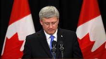Canadian Prime Minister Stephen Harper answers questions on the train explosion in Quebec in Calgary, Alberta, July 6, 2013. (TODD KOROL/REUTERS)