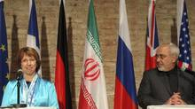 European foreign policy chief Catherine Ashton, left, and Iranian Foreign Minister Mohammad Javad Zarif, address the media after closed-door nuclear talks in Vienna, Saturday, July 19, 2014. (Ronald Zak/Associated Press)