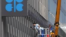 Workers clean the windows of the Organization of the Petroleum Exporting Countries (OPEC) headquarters in Vienna April 7, 2014. (HEINZ-PETER BADER/REUTERS)