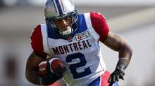 Montreal Alouettes' Brandon Whitaker, runs the ball during first half CFL action against the Calgary Stampeders in Calgary, Alta., Saturday, July 20, 2013. (Jeff McIntosh/THE CANADIAN PRESS)