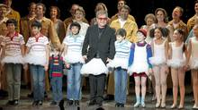 Sir Elton John wears a tutu as he joins the cast of the stage adaptation Billy Elliot The Musical for their curtain call following the show's premiere in Toronto on March 1, 2011. (Chris Young/Chris Young/The Canadian Press)