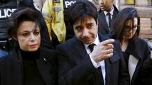 Former radio host Jian Ghomeshi, charged with multiple counts of sexual assault, leaves a Toronto courthouse after the first day of his trial, with his lawyer Marie Henein, left, on Feb. 1. (MARK BLINCH/REUTERS)