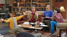 """This publicity image released by CBS shows, from left, Kunal Nayyar, Johnny Galecki, Jim Parsons and Simon Helberg in a scene from """"The Big Bang Theory."""" The studio that produces """"The Big Bang Theory"""" said it has reached contract deals with the sitcom's cast and the show will begin production Wednesday, Aug. 6, 2014, for the new season. (AP Photo/CBS, Monty Brinton, FIle)"""